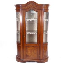 A mahogany bow-end display cabinet, with arch-top glazed and panelled door, and 2 fitted shelves,