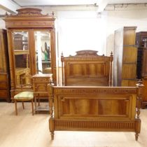 """An Antique French walnut bedroom suite, comprising a mirrored 2-door armoire, a 4'6"""" carved and"""