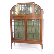 A late Victorian mahogany display cabinet of arch-top form, satinwood banded, astrocal glazed doors,
