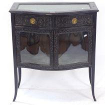 An ebonised vitrine display cabinet of serpentine form, W78cm, H88cm, D41cm
