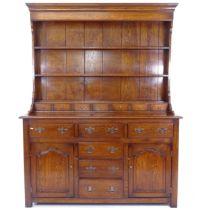 A reproduction oak Welsh dresser, W153cm, H198cm, D53cm