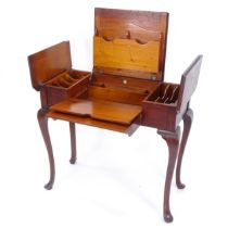 An Edwardian metamorphic writing table, with label for Britisher, W90cm, H76cm, D45cm
