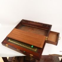 A large 19th century brass-bound mahogany writing slope, with secret drawer and recessed handles,