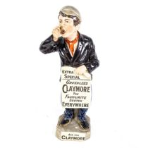 A large ceramic Greenlees Claymore Favourite Scotch advertising figure, modelled as a newspaper boy,