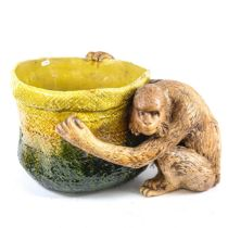 A large Bretby figural pottery jardiniere, modelled as a monkey holding a basket, model no. 1251,