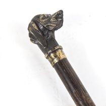 A reproduction figural Gundog walking cane, brass dog-head knop with hardwood shaft, length 87cm