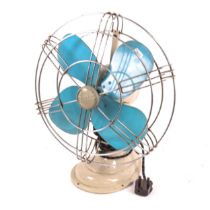 """A mid-century 12"""" Aermaster desk fan, blue propellers with steel cage"""