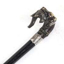 A Victorian ebonised walking cane, with silver collar and reproduction brass hunting dog and