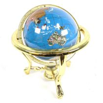 A reproduction brass and hardstone table-top terrestrial globe, with compass inset base, overall