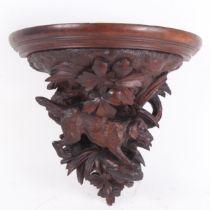 A Black Forest carved wood dog wall bracket, H32cm, W36cm