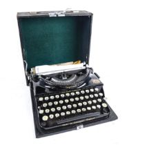 A Vintage Imperial Good Companion typewriter, serial no. BE872, barrel length 23cm, in travelling