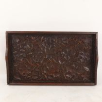 An Indian carved and stained hardwood grapevine tea tray, 54cm x 32cm