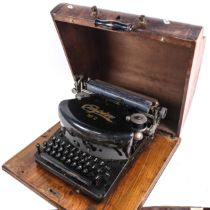 A Vintage Empire No. 2 typewriter, barrel length 24cm, in fitted case