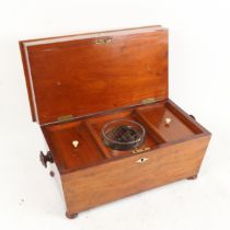 An unusual Victorian mahogany double-compartment sarcophagus tea caddy, top layer concealing