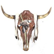 TAXIDERMY - a large hand painted cow skull and horns, painted decoration of golden eagle, by