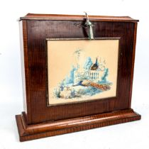 A mahogany desk-top stationery cabinet, circa 1900, the fall-front having an inset watercolour panel