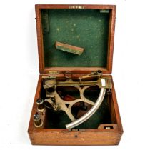 A brass sextant by Feathers & Son of Dundee, with ivory scale and spare lenses in original fitted