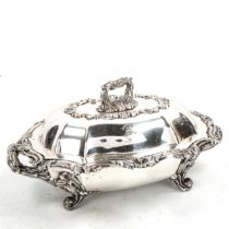 An ornate Victorian electroplate vegetable tureen and cover on stand, with relief cast acanthus leaf