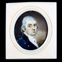 A miniature painted portrait on ivory of a gentleman wearing a blue coat, unsigned, late 18th/