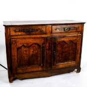 A French 18th century Poplar dresser base, with 2 frieze drawers and panelled cupboards under, width