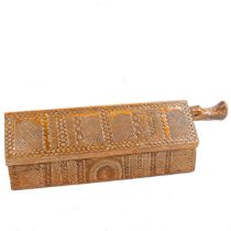 A Folk Art chip carved mahogany novelty candle / offertory box, in the form of a house, with allover