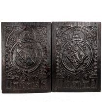 A pair of 17th century relief carved oak panels dated 1619, bearing the coats of arms of Thomas