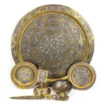 A group of Persian brass items, comprising a circular tray, diameter 38cm, a relief