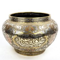 A large Persian brass jardiniere, late 19th century, with intricate inlaid silver and