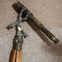A brass and leather-covered 4-draw telescope, by J H Steward of 106 Strand London, on brass
