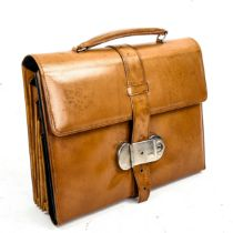 A Victorian tan leather travelling writing case, with green leather fitted interior, 28cm x 22cm