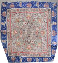 A fine quality Oriental hand embroidered crewelwork table cover, the central panel intricately