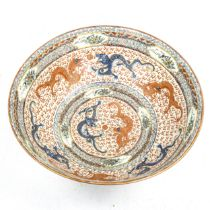 A Chinese porcelain dragon bowl, probably mid-20th century, hand painted and gilded decoration,