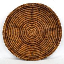 Hopi Native American (Arizona) hand woven wicker basket, diameter 53cm Some minor damage or wear