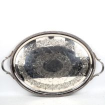 A large Victorian electroplate 2-handled tea tray, length excluding handles 62cm Plating is slightly