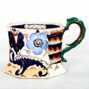 A good masons ironstone pottery hydra mug of octagonal outline, circa 1810