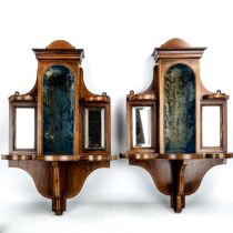 A pair of late Victorian rosewood wall brackets, central velvet-lined alcoves flanked by bevel