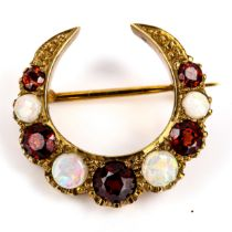 A late 20th century 9ct gold opal and garnet crescent brooch, set with round cabochon opals and