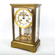 An early 20th century brass-cased 4-glass 8-day mantel clock, by Payne & Co of London, white