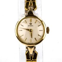OMEGA - a lady's Vintage gold plated mechanical wristwatch, ref. 2873-6, circa 1958, silvered dial
