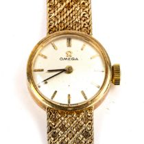 OMEGA - a lady's Vintage 9ct gold mechanical bracelet watch, silvered dial with gilt baton hour