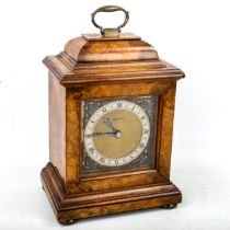 An early/mid-20th century Mappin & Webb burr-walnut bracket clock, brass dial with Roman numeral