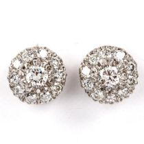 A pair of diamond cluster stud earrings, unmarked white metal settings with modern round brilliant