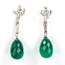 A fine pair of emerald and diamond drop earrings, unmarked white metal settings, with briolette-