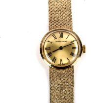 JAEGER LE COULTRE - a lady's 9ct gold mechanical bracelet watch, champagne dial with Roman numeral