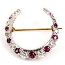 A late 20th century 9ct gold ruby and diamond crescent brooch, set with round cut gemstones, total