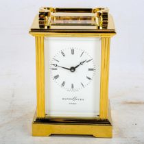 A modern Mappin & Webb brass-cased carriage clock, white dial with Roman numeral hour markers and
