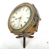 A Victorian bronze novelty timpani drum clock, with tripod stick stand, silvered dial with Roman