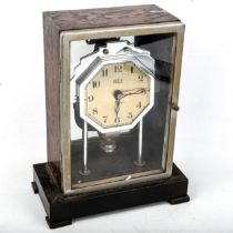 A Vintage Bulle electro-magnetic mantel clock, silver dial with Arabic numerals and stained oak
