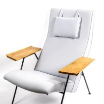 ROBIN DAY, ergonomic reclining chair, with broad oak arm rest on iron frame, from 1952 design Twenty