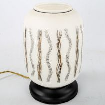 A 1950s/60s Italian white glass table-top lamp, with black and gold decoration, height 28cm Fully